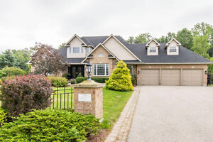 Beautiful 5 Bedroom Home on 1+ acre treed lot