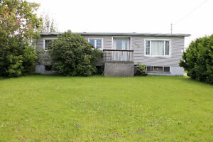 3 BEDROOM HOME IN VAL THERESE WITH DBL DETACHED, HEATED GARAGE!