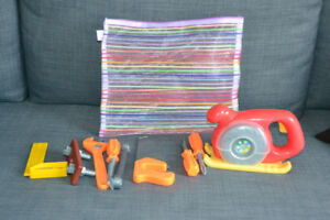 Bag of assorted stuffies/puppets plus children's tool set