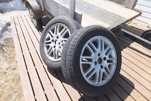 Tires and rims off a 2007 Ford Focus