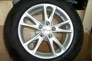 WINTER TIRES 225/65-R 17 ON ALLOY RIMS (MAGS).
