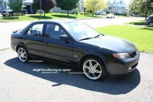 Mazda Protege ES/GT 2.0l 5 vit. noire 2002 - À qui la chance ?