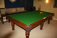 pool table with table cover and chairs