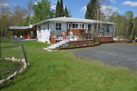 A GREAT HOME AND ACREAGE ON HWY 17 WEST KEEWATIN