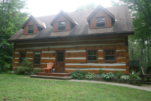 Log home for rent steps from Burkes beach