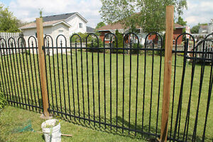 3 wrought iron fence panels.