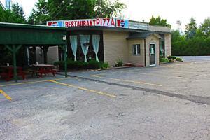 Batisse sur terrain avec fonds de commerce RESTAURANT PIZZA