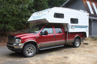 F350 truck with slide on truck camper