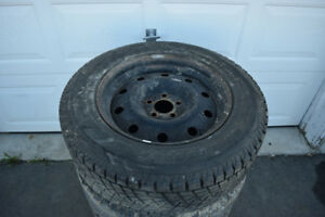 Chrysler 300 235/65/17 Bridgestone Snows On Rims 55% Tread