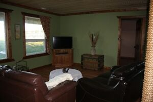 Fully furnished 1200 sq ft rental located on acreage within 15 m