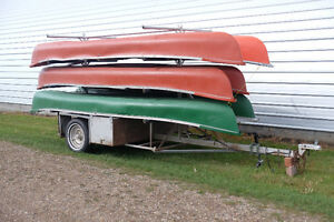 Coleman canoes (6) and trailer, spare tire & paddles