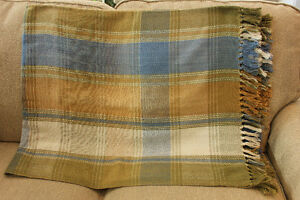 Beautiful plaid and floral throws