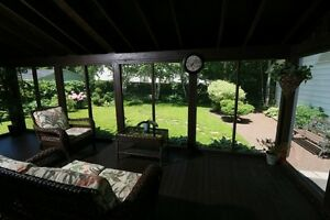 Screened Patio overlooking Private Back Yard!