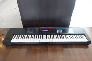 Clavier Roland juno ds 88 comme neuf