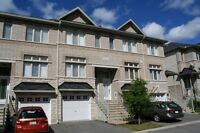 Executive townhouse in popular Citiplace backing onto ravine!