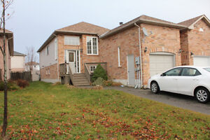 Main floor Legal Duplex with garage in south Barrie!