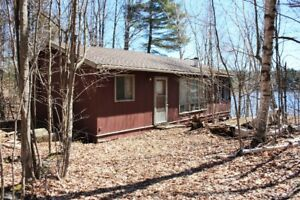 Lovely waterfront cottage with 3 lots for sale on Troy Lake