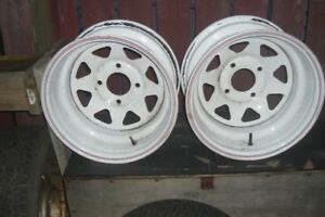 TWO 15 INCH TRAILER RIMS WITH 4 HOLE MOUNT