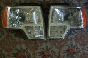 A PAIR OF FORD F150 HEADLIGHT ASSEMBLIES CAN SEPERATE