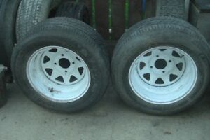 TWO   4 HOLE 15 INCH TRAILER RIMS WITH TIRES