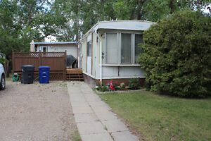Mobile Home on Owned Lot in Weyburn!
