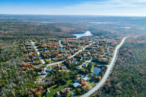 APPROX. 50 ACRES OF LAKE FRONT AND LAKE VIEW LOTS
