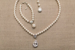 White/Ivory pearl set with beautiful Zirconium accents.