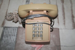 Old fashion telephone. Push button. Works fine.