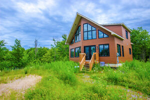 Beautiful Chalet Home on 40 Acres beside Troy Lake