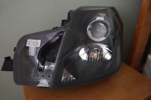 OEM 2004 Cadillac CTS Headlight assembly, Drivers side