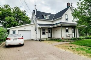 Century home of 1,900 sf located on a corner lot