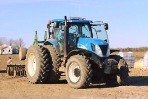 2010 New Holland 7050 Tractor with Brent 420 Grain Cart