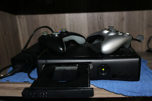 Xbox 360, 2 controllers, and 4 games in amazing condition!