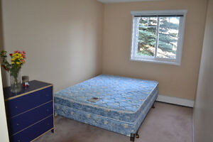 Room for rent for a female, 2-bdrm condo, Dalhousie, NW July 1