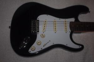 guitare électrique en état excellent, comme neuve
