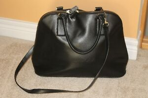 Black Express purse with shoulder strap