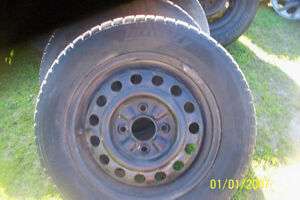 4 KIA SPECTRA 15 INCH RIMS 4 BOLT 3 TIRES OK ONE IS BALLED