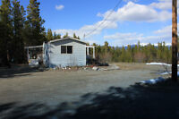 REDUCED PRICE Country residential view lot 15 minutes from town.