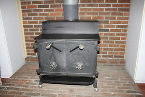 Fisher 2-door cast iron wood stove REDUCED
