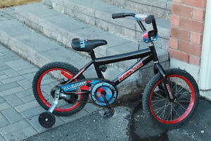 """Boy's Bike with 16"""" tires and training wheels"""