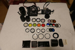Two CANON 35mm SLR Cameras & accessories.