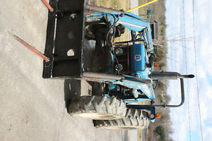tractor with loader, snow blowers, blades, wood splitters