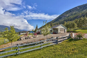 Stunning 3 Bedroom Rancher with River and Mountain Views!