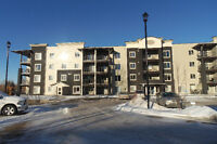 Brand New & Top Floor 2015 Built 2 Bed 2 Bath Condo in Cochrane!