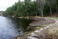 OVER 3 ACRES WATERFRONT ON BEAUTIFUL FRENCH RIVER!