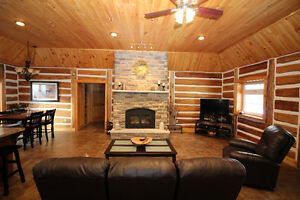 Custom log home in tranquil woodland setting
