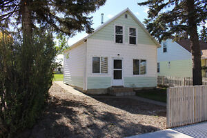 Reduced by $10,000!!!   223 Highway Ave Picture Butte