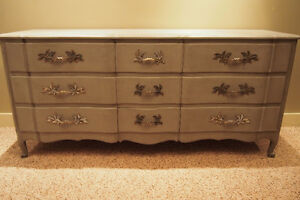 Unique, antique and beautiful refinished nine drawer dresser!