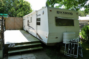 Travel Trailer on Pretty Site at Sand Hill Park