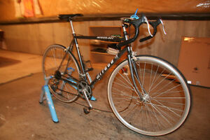 "Miyata 21 speed , 21"" road bike and TACX trainer"